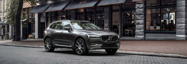 2019 Volvo XC60 parked in front of storefront