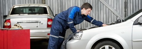 Service technician servicing car