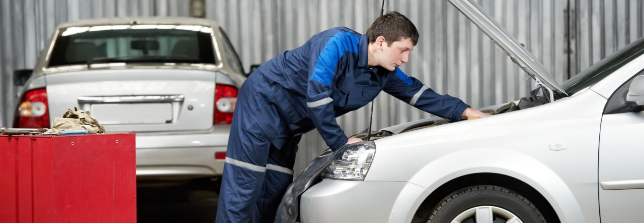 Service technician servicing car